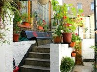 The attractive gardens and exterior of Camden Inn Hostel