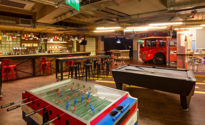 Enjoy a game in the pool room at Generator Hostel