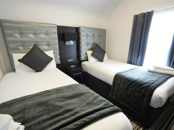 A spacious twin room at Airways Hotel