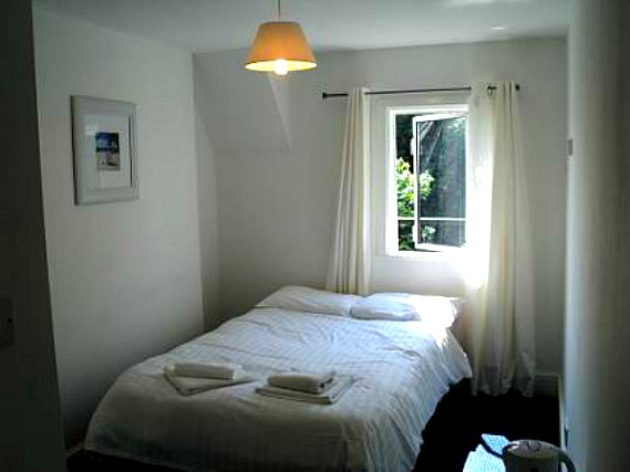 Rest easy in a comfortable bed in your room at Amhurst Hotel