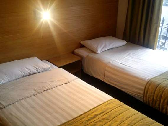 A spacious twin room at Arriva Hotel