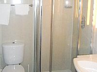 The refurbished bathroom facilities at Hotel 261 are modern and are cleaned daily
