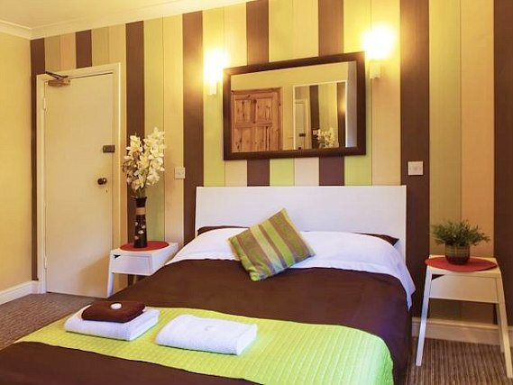 Stay in comfort at Hotel 261 in one of the grand double bedrooms