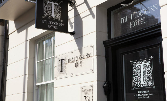 An exterior view of Tudor Inn Hotel