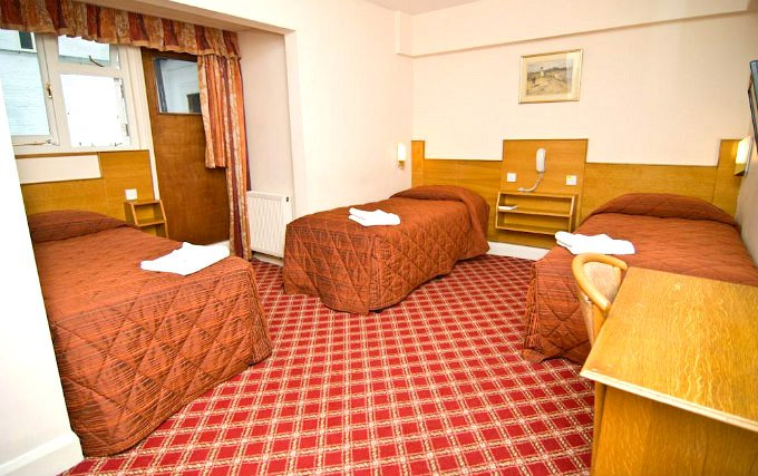 A comfortable triple room at Alexandra Hotel