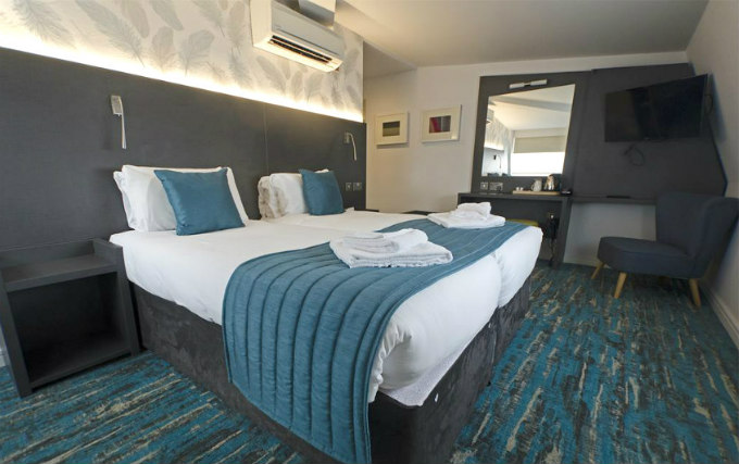 A comfortable twin room at K Hotel Kensington