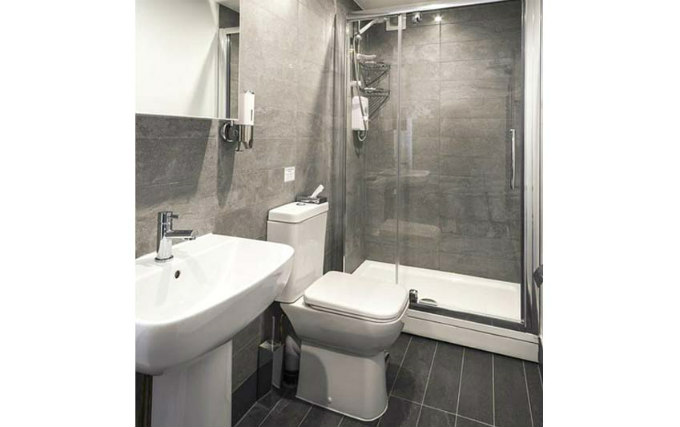 A typical shower system at Smart Stay Swiss Cottage