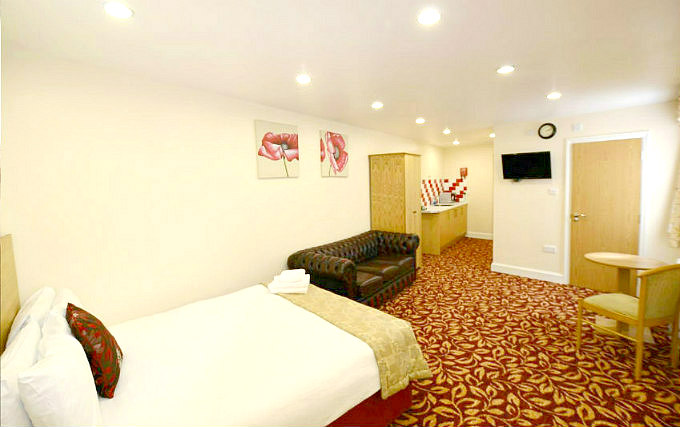 A comfortable double room at PremierLux Serviced Apartments