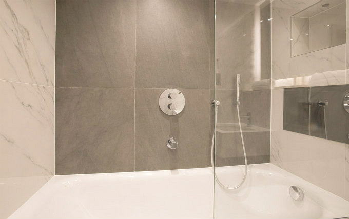 A shower system at Merit Kensington Hotel