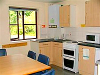 A typical kitchen and lounge area where you can make your own meals, helping to save money