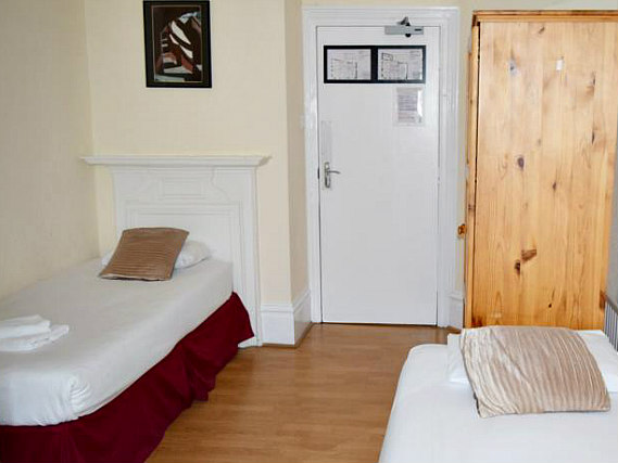 A twin room at Black Lion Guesthouse London is perfect for two guests