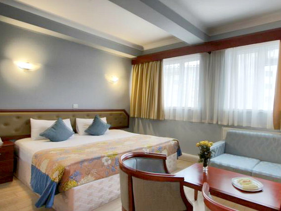 Get a good night's sleep in your comfortable room at St Georgio Hotel