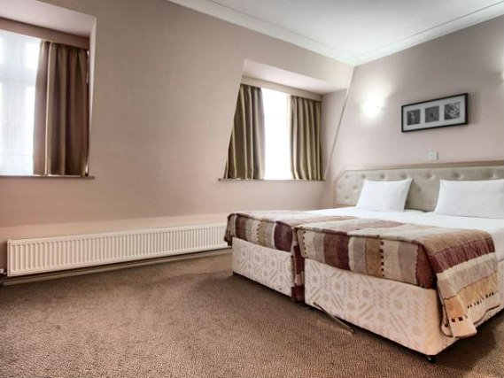 A twin room is perfect for two guests at St Georgio Hotel