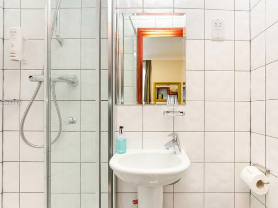 Relax in the private bathroom in your room at Wardonia Hotel