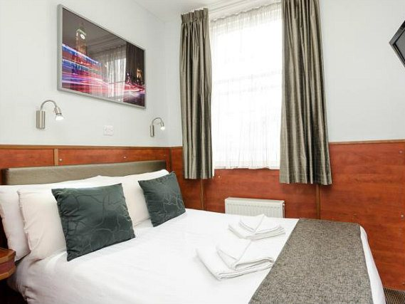 Rest easy in a comfortable bed in your room at Wardonia Hotel