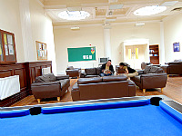Chill out, chat, or play pool in the communal room at Furnival House