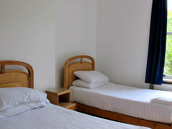 A twin room at Access Apartments Earls Court