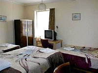 A triple room at Charlies Hotel London