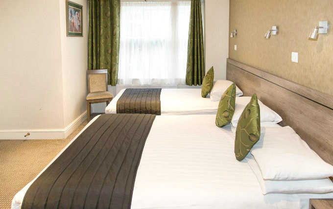 A typical triple room at Kensington Garden Hotel