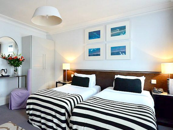 A twin room at Kensington Rooms Hotel is perfect for two guests