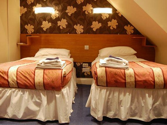 A twin room at Anchor House Hotel is perfect for two guests