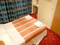 A cosy, warm double room at the Anchor House Hotel