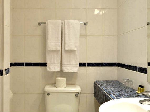 Relax in the private bathroom in your room at The Princes Square Hotel