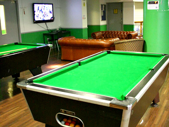 Common room with pool table and lounge