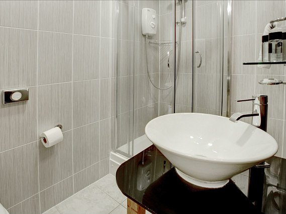 Relax in the private bathroom in your room