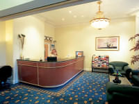 The reception area at Abcone Hotel London