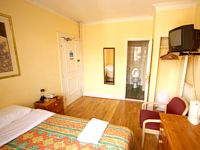 A Double room at Camelot House Hotel