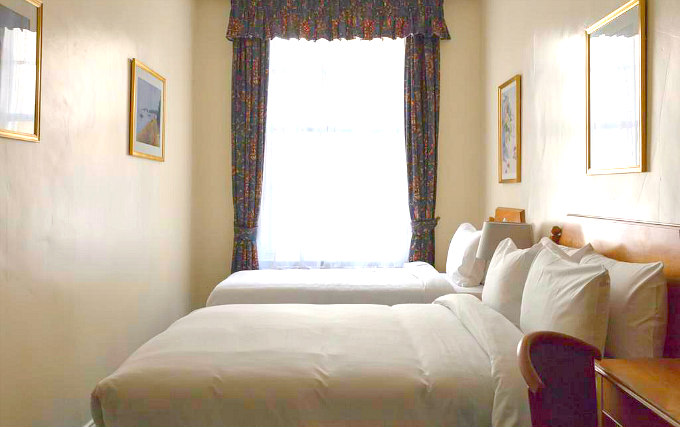 A typical triple room at Victor Hotel London Victoria