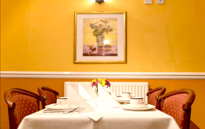 Relax and enjoy your meal in the Dining room at Victor Hotel London Victoria