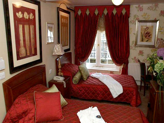 A twin room at Opulence Central London