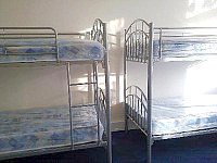 A dorm room, providing basic but comfortable accommodation to larger groups