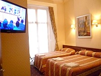 A typical triple room at the Avon Hotel London