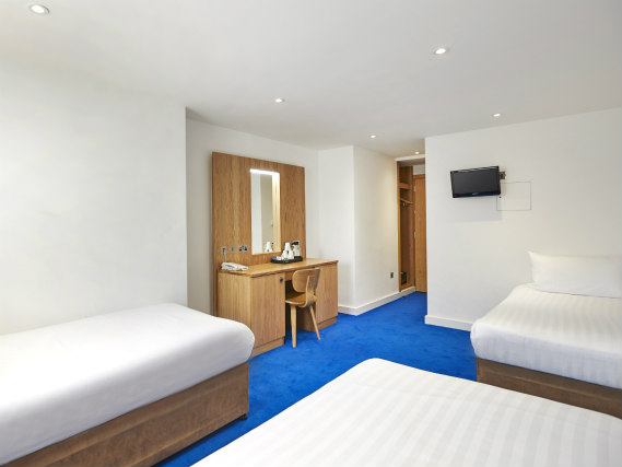 A typical quad room at Central Park Hotel London