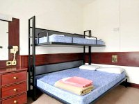 A typical triple room at Equity Point Hostel
