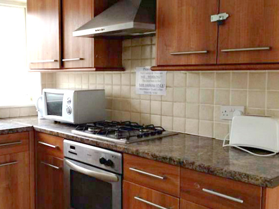 The kitchen at Rooms For You is fully equipped includes a toaster and microwave