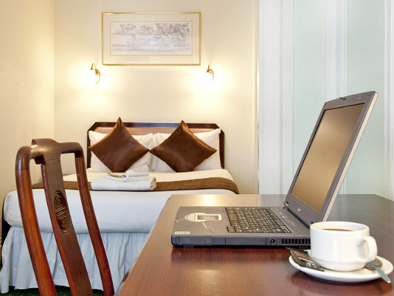 Enjoy a hot drink thanks to the tea/coffee making facilities in your room at Astor Court Hotel