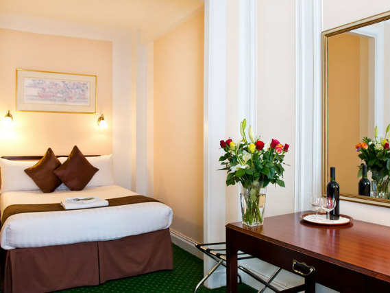 Rest easy in a comfortable bed in your room at Astor Court Hotel