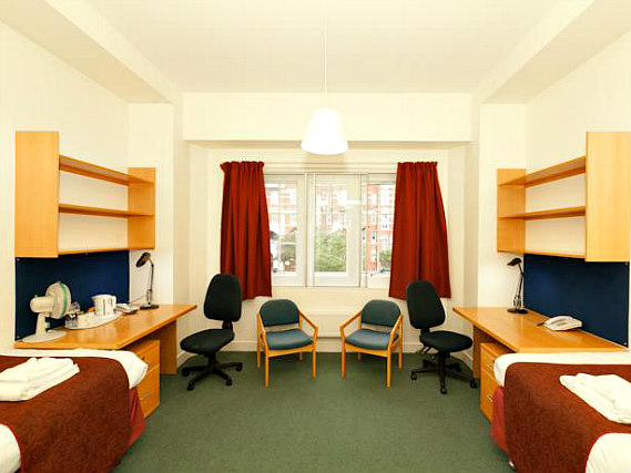 A twin room at Beit Hall London is perfect for two guests