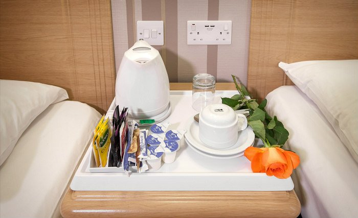 Enjoy a hot drink thanks to the tea/coffee making facilities in your room at Fairway Hotel London