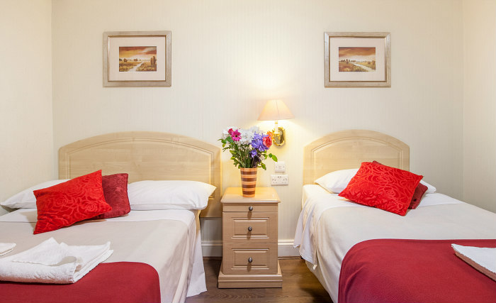 A twin room at Fairway Hotel London is perfect for two guests
