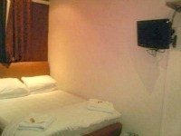 A typical double room at Old Friend Hotel