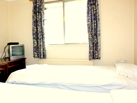 A spacious twin room at Heathrow Lodge
