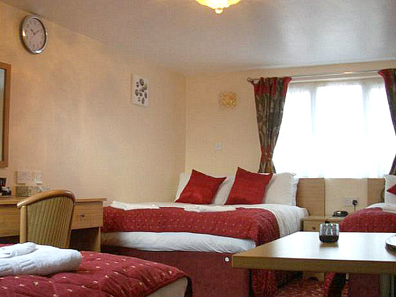 Get a good night's sleep in your comfortable room at Britannia Inn Hotel