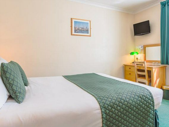 Relax and unwind, and watch TV after a busy day in your cosy double room
