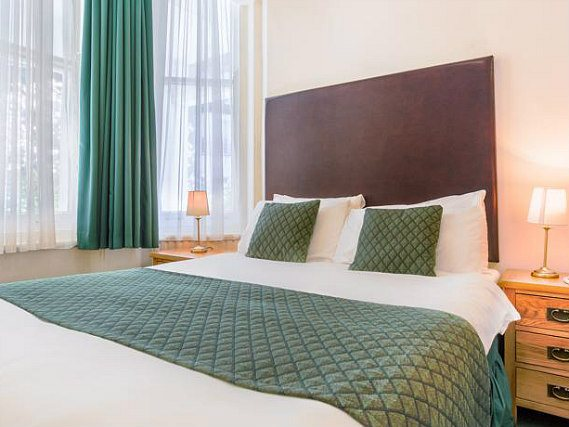 Get a good night's sleep in your comfortable room at London Town Hotel