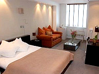 A large guest room at City Hotel London